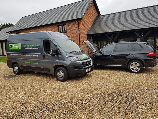 Mobile mechanic van servicing a car - Bracknell