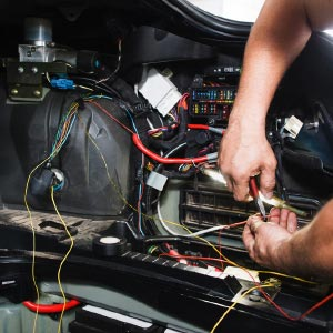 mobile mechanic repairing electrical fault on a vehicle